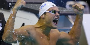 Manaudou of France celebrates victory in the men's 100m freestyle final at the European Swimming Championships in Berlin