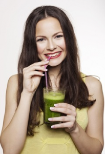 woman-drinking-green-smoothie-with-a-straw